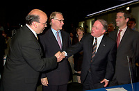 June 6 , 2002, Montreal, Quebec, Canada<br /> Frank Zampino, Montreal City Executive Commitee (L) <br /> Gerald Tremblay, Montreal (new) Mayor (M-L)<br /> Bernard Landry, Quebec Premier (M-R), <br /> Andre Boisclair, Quebec Minister Municipal Affairs, Quebec Minister Environment<br /> shake hands after signing a partnership agreement between the Quebec Gouvernment and the <br /> new City of Montreal (after all cities on the Montreal islanf merged with Montreal City), <br /> at the closing of the Montreal Summit (Le Sommet de Montr&raquo;al), June 6, 2002<br />  <br /> Mandatory Credit: Photo by Pierre Roussel- Images Distribution. (&copy;) Copyright 2002 by Pierre Roussel <br /> ON SPEC<br /> NOTE l Nikon D-1 jpeg opened with Qimage icc profile, saved in Adobe 1998 RGB.