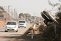 Mar. 13, 2011 - Kita-Ibaraki, Japan - A car is shown are shown piled up on the street two days after the 8.9 magnitude earthquake struck followed by a tsunami that hit the north-eastern region. The death toll is currently unknown with casualties that may run well into the thousands.