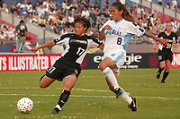 Ronnie Fair of the New York Power battles Homare Sawa of the Atlanta Beat for the ball during the Power's 2-0 loss to the Beat on June 9th at Mitchel Athletic Complex.