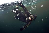 Photographer Fredrik Naumann freediving under the ice at Lutvann lake,outside Oslo, Norway. Photo: Terje Brandshaug.