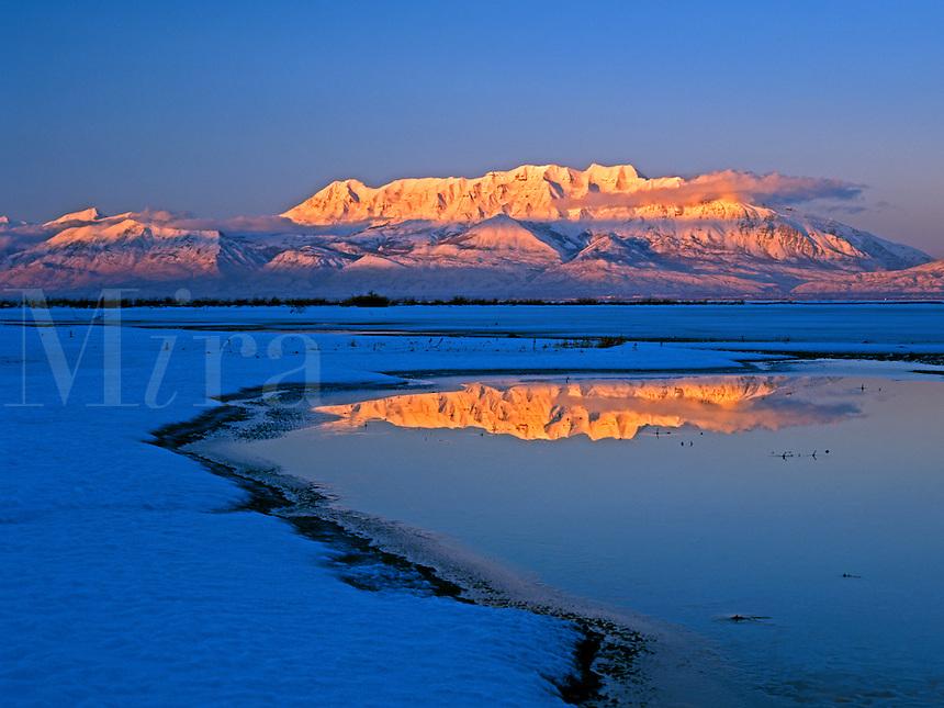 Mount Timpanogos rises above Utah Lake in central Utah in this winter scene