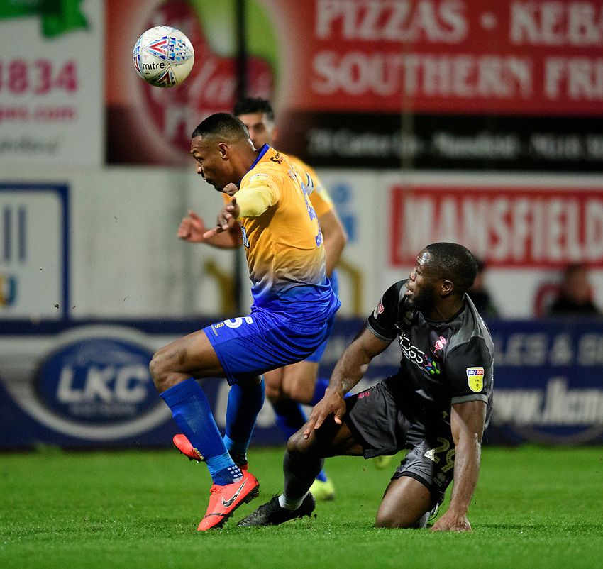 Lincoln City's John Akinde vies for possession with Mansfield Town's Krystian Pearce<br /> <br /> Photographer Chris Vaughan/CameraSport<br /> <br /> The EFL Sky Bet League Two - Mansfield Town v Lincoln City - Monday 18th March 2019 - Field Mill - Mansfield<br /> <br /> World Copyright © 2019 CameraSport. All rights reserved. 43 Linden Ave. Countesthorpe. Leicester. England. LE8 5PG - Tel: +44 (0) 116 277 4147 - admin@camerasport.com - www.camerasport.com