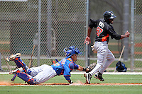Miami Marlins Kentrell Dewitt #67 is tagged out by catcher Alex Machillanada #60 in a run down during an extended Spring Training game against the New York Mets at the Roger Deam Complex on May 1, 2012 in Jupiter, Florida.  (Mike Janes/Four Seam Images)