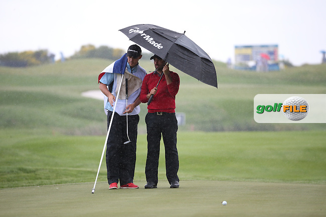 The umbrella is up for John Parry (ENG) during Round One of the 100th Open de France, played at Le Golf National, Guyancourt, Paris, France. 30/06/2016. Picture: David Lloyd   Golffile.<br /> <br /> All photos usage must carry mandatory copyright credit (&copy; Golffile   David Lloyd)