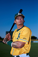 AZL Athletics Gold Yhoelnys Gonzalez (12) poses for a photo before an Arizona League game against the AZL Rangers on July 15, 2019 at Hohokam Stadium in Mesa, Arizona. The AZL Athletics Gold defeated the AZL Rangers 9-8 in 11 innings. (Zachary Lucy/Four Seam Images)