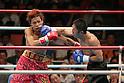 (L-R) Noriyuki Komatsu, Daisuke Naito (JPN), JUNE 27, 2006 - Boxing : Daisuke Naito of Japan hits Noriyuki Komatsu of Japan during the OPBF and Japanese flyweight titles bout at Korakuen Hall in Tokyo, Japan. (Photo by Hiroaki Yamaguchi/AFLO)