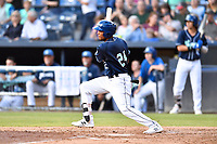 Asheville Tourists Daniel Montano (24) swings at a pitch during a game against the Lakewood BlueClaws at McCormick Field on August 3, 2019 in Asheville, North Carolina. The BlueClaws defeated the Tourists 10-6. (Tony Farlow/Four Seam Images)
