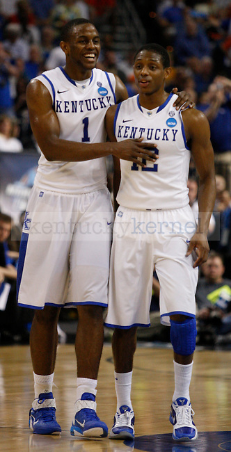 Teammates Darius Miller and Brandon Knight walk together near the end of UK's second game of the 2011 NCAA Basketball Tournament, at the St. Pete Times Forum, in Tampa, Fl.  Kentucky beat West Virginia 71-63.  Photo by Latara Appleby   Staff