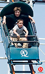 MIDDLEBURY, CT- 27 APRIL 2008- 042708JT13-<br /> Aaron Andress, 9, above, and Adam Caron, 6, both of Bristol, brace themselves for a drop on the Monster Coaster ride at Quassy Amusement park on Saturday, April 26 during the park's 100th season opening.<br /> Josalee Thrift / Republican-American