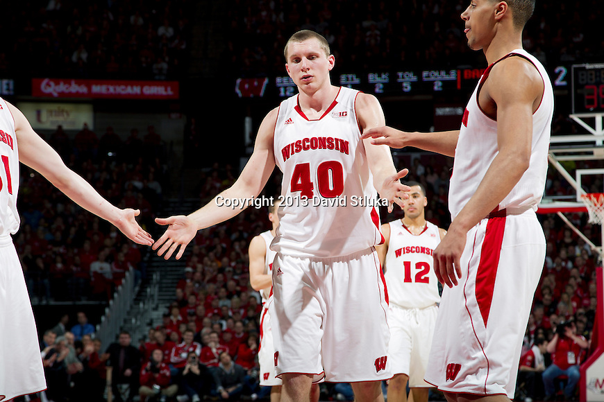 Wisconsin Badgers forward Jared Berggren (40) celebrates with teammates during a Big Ten Conference NCAA college basketball game against the Michigan Wolverines Saturday, February 9, 2013, in Madison, Wis. The Badgers won 65-62 (OT) (Photo by David Stluka)