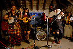 'CLAN, THE' SCOTLAND, A GROUP WHO SPEND THEIR WEEKENDS AT A CAMP IN GLEN CROE, RECREATING THE LIFE OF A SCOTTISH CLAN BEFORE THE DEFEAT OF BONNIE PRINCE CHARLIE BY THE ENGLISH AT THE BATTLE OF CULLODEN IN 1746. THE CLAN PLAYING AT A BIRTHDAY PARTY CEILIDH HELD IN ARDFERN ON THE WEST COAST, 1989