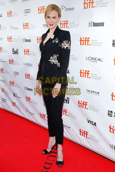 Nicole Kidman<br /> &quot;The Railway Man&quot; Premiere, 2013 Toronto International Film Festival held at Roy Thomson Hall, Toronto, Ontario, Canada, USA, <br /> 6th September 2013.<br /> TIFF full length black jacket trousers suit heels shoes bows patterned lace cut out <br /> CAP/ADM/BPC<br /> &copy;Brent Perniac/AdMedia/Capital Pictures