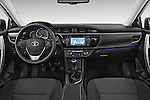 Stock photo of straight dashboard view of a 2014 Toyota Corolla Comfort 4 Door Sedan 2WD Dashboard