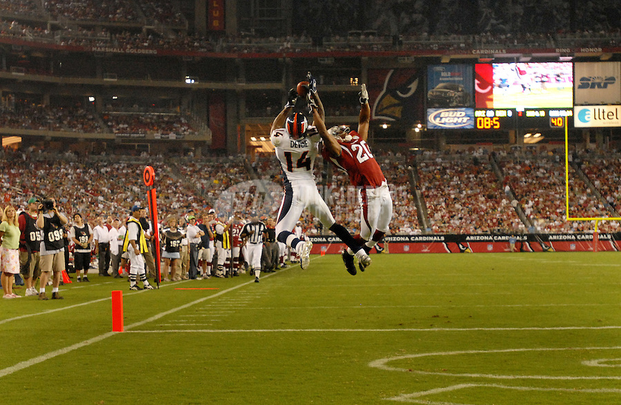 Aug. 31, 2006; Glendale, AZ, USA; Denver Broncos wide receiver (14) Todd Devoe catches a touchdown pass  against Arizona Cardinals cornerback (20) Lamont Reid at Cardinals Stadium in Glendale, AZ. Mandatory Credit: Mark J. Rebilas