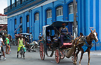 Cardenas Cuba downtown color and traffic in beautiful small town cars peditaxis and horse carriages on streets