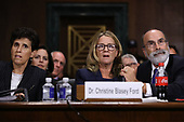 WASHINGTON, DC - SEPTEMBER 27:  Christine Blasey Ford (C) is flanked by her attorneys Debra Katz (L) and Michael Bromwich as she testifies before the Senate Judiciary Committee in the Dirksen Senate Office Building on Capitol Hill September 27, 2018 in Washington, DC. A professor at Palo Alto University and a research psychologist at the Stanford University School of Medicine, Ford has accused Supreme Court nominee Judge Brett Kavanaugh of sexually assaulting her during a party in 1982 when they were high school students in suburban Maryland. In prepared remarks, Ford said, ÒI donÕt have all the answers, and I donÕt remember as much as I would like to. But the details about that night that bring me here today are ones I will never forget. They have been seared into my memory and have haunted me episodically as an adult.Ó  (Photo by Win McNamee/Getty Images)
