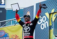 Sep 13, 2013; Charlotte, NC, USA; NHRA top fuel dragster driver Antron Brown during qualifying for the Carolina Nationals at zMax Dragway. Mandatory Credit: Mark J. Rebilas-