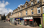 Shops in historic buildings in Hawick, Roxburghshire, Scotland, UK
