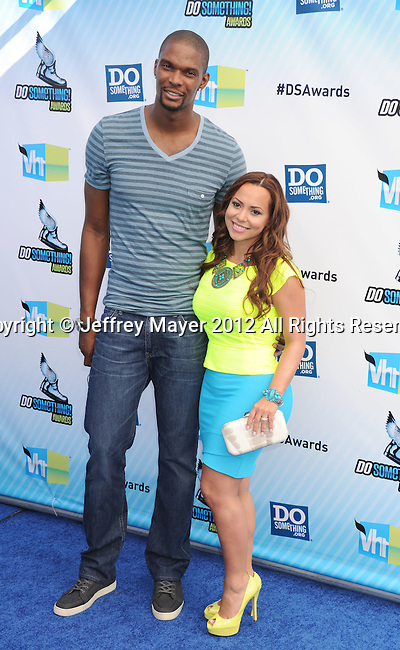 SANTA MONICA, CA - AUGUST 19: Chris Bosh and Adrienne Williams arrive at the 2012 Do Something Awards at Barker Hangar on August 19, 2012 in Santa Monica, California.