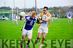 BREAKING OUT:  Templenoe full forward Teddy Doyle sets off on another upfield surge despite the attentions of Bandon's Ronan Crowley.