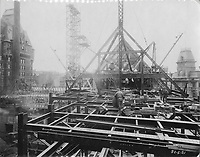 Construction work on the front wing of the Chateau Frontenac, photograph, 1921, from the Archives of the Chateau Frontenac, Quebec City, Quebec, Canada. The Chateau Frontenac opened in 1893 and was designed by Bruce Price as a chateau style hotel for the Canadian Pacific Railway company or CPR. It was extended in 1924 by William Sutherland Maxwell. The building is now a hotel, the Fairmont Le Chateau Frontenac, and is listed as a National Historic Site of Canada. The Historic District of Old Quebec is listed as a UNESCO World Heritage Site. Copyright Archives Chateau Frontenac / Manuel Cohen