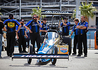 Oct 28, 2016; Las Vegas, NV, USA; Crew members with NHRA top fuel driver Morgan Lucas during qualifying for the Toyota Nationals at The Strip at Las Vegas Motor Speedway. Mandatory Credit: Mark J. Rebilas-USA TODAY Sports