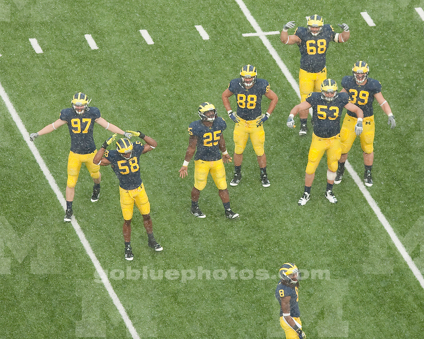 The University of Michigan football team beat Western Michigan University 34-10 in a rain-shortened game at Michigan Stadium in Ann Arbor, Mich., on September 3, 2011.