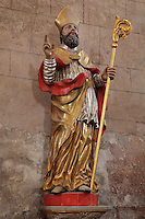 Statue of St Thomas a Becket, 1117-70, patron saint of the now destroyed church of Conques, in the North transept of the Abbatiale Sainte-Foy de Conques or Abbey-church of Saint-Foy, Conques, Aveyron, Midi-Pyrenees, France, a Romanesque abbey church begun 1050 under abbot Odolric to house the remains of St Foy, a 4th century female martyr. The church is on the pilgrimage route to Santiago da Compostela, and is listed as a historic monument and a UNESCO World Heritage Site. Picture by Manuel Cohen