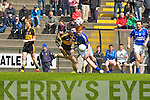 Aaron gamble Laune Rangers goes past Daithi Casey Dr Crokes during their Club Championship semi final in Killarney on Sunday