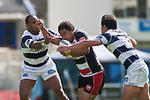 Simon Lemalu tries to burst between Joe Rokocoko & Onosa'i Auva'a. Air New Zealand Cup Rugby game between Counties Manukau & Auckland played at Eden Park Auckland on Sunday October 18th 2009..Auckland won the game 37 - 14.