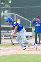 Team Italy outfielder Giovanni Garbella (27) starts down the first base line during an exhibition game against the Oakland Athletics at Lew Wolff Training Complex on October 3, 2018 in Mesa, Arizona. (Zachary Lucy/Four Seam Images)