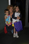 "Liz Kiefer (Blake) poss with her children Kiefer and Ilisabella at their ""Bloss and Friends"" bowling event at the Port Authority Bowling lanes to benefit the Cancer Foundation on October 9, 2004 (Photo by Sue Coflin)"