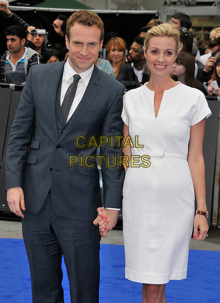 Rafe Spall and Elize Du Toit .The 'Prometheus' world film premiere, Empire cinema, Leicester Square, London, England..May 31st, 2012.half length dress grey gray suit holding hands white married husband wife .CAP/WIZ.© Wizard/Capital Pictures.