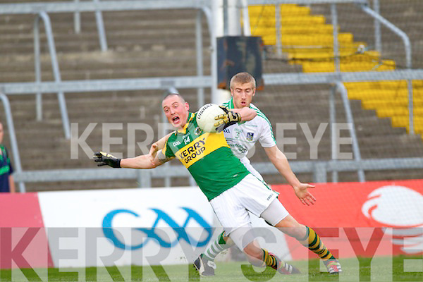 Shane Gallagher pulls down Kieran Donaghy in the Muster Senior Semi final held in The Gaelic Grounds last Saturday evening.