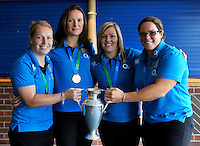 High Wycombe, England. Wasps' Rugby World Cup winning ladies La Toya Mason, Joanna McGilchrist, Marlie Packer, Claire Purdy, with the World Cup trophy at the Aviva Premiership match between Wasps and Northampton Saints at Adams Park on September 14, 2014 in High Wycombe, England.