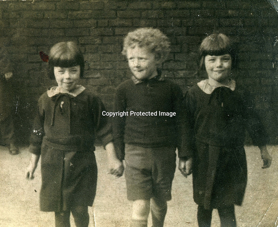 BNPS.co.uk.(01202 558833)<br /> Pic: FinnWebster/BNPS<br /> <br /> Nevile Jones and sisters Edna and Iris in 1936.<br /> <br /> Britain's oldest set of triplets whose combined weight at birth was the same as a normal baby have celebrated their 85th birthday.<br /> <br /> Neville Jones and sisters Edna Doodson and Iris Hopkin were born just 20 minutes apart in June 1929.<br /> <br /> Twins had run in the family and their mother Margaret had been expecting two babies before youngest sibling Iris arrived to make it a hat-trick.<br /> <br /> She weighed just 2lbs and was given little chance of survival but pulled through. Edna weighed 3lbs and Neville a healthier 4lbs.