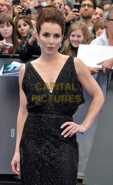 Noomi Rapace.The 'Prometheus' world film premiere, Empire cinema, Leicester Square, London, England..May 31st, 2012.half length black dress sleeveless hand on hip sheer beads beaded .CAP/WIZ.© Wizard/Capital Pictures.