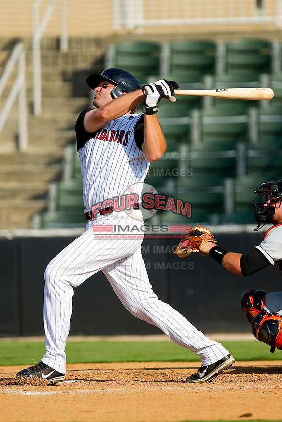 Dan Black #40 of the Kannapolis Intimidators follows through on his swing against the Delmarva Shorebirds at Fieldcrest Cannon Stadium on August 7, 2011 in Kannapolis, North Carolina.  The Intimidators defeated the Shorebirds 8-3.   (Brian Westerholt / Four Seam Images)