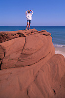 Ile du Havre-aux-Maisons, Iles de la Madeleine, Quebec, Canada - Model Released Woman standing on Sandstone Cliffs at Dune du Sud along Gulf of St. Lawrence - (South Dune, House Harbour Island, Magdalen Islands)