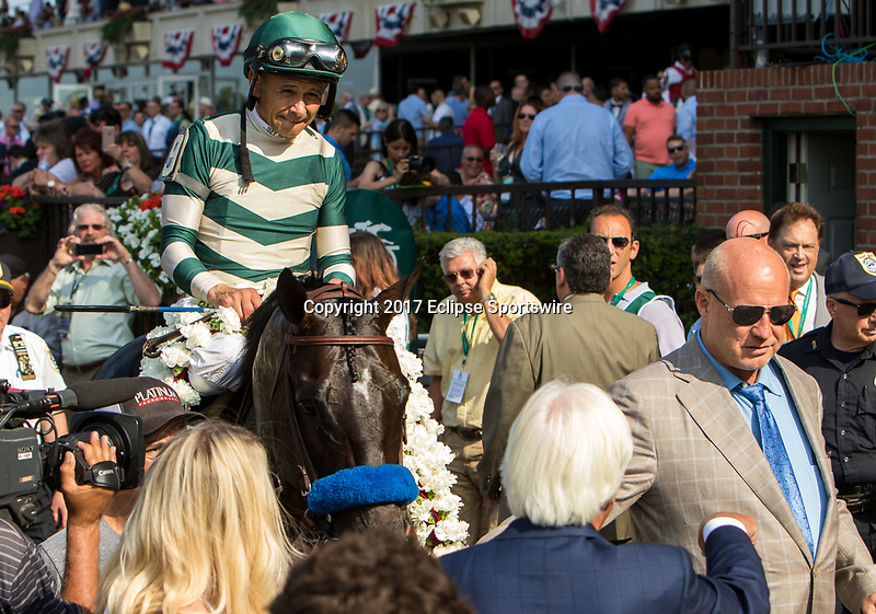 ELMONT, NY - JUNE 10: Mike Smith, aboard Mor Spirit #9, is led to the winner's circle after winning the Mohegan Sun Metropolitan Handicap on Belmont Stakes Day at Belmont Park on June 10, 2017 in Elmont, New York (Photo by Sue Kawczynski/Eclipse Sportswire/Getty Images)