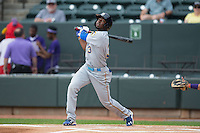 Shawon Dunston Jr. (3) of the Myrtle Beach Pelicans follows through on his swing against the Winston-Salem Dash at BB&T Ballpark on April 18, 2015 in Winston-Salem, North Carolina.  The Pelicans defeated the Dash 4-1 in game one of a double-header.  (Brian Westerholt/Four Seam Images)