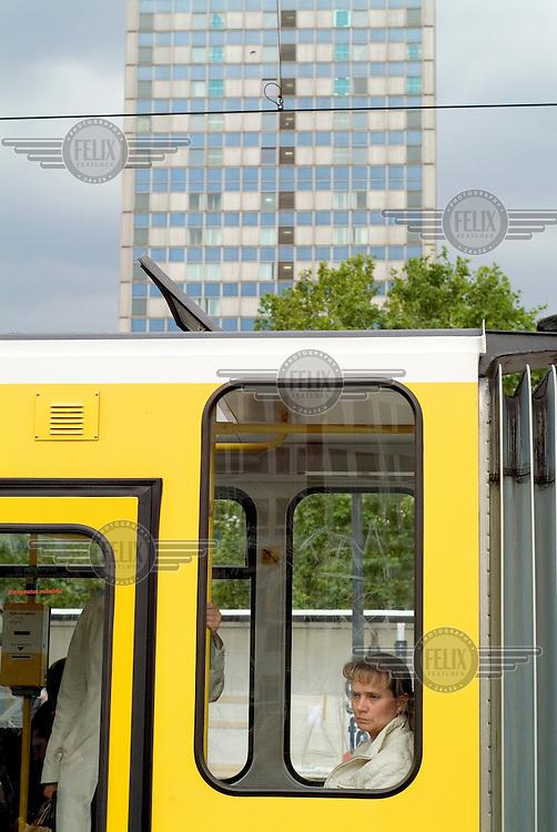 Bored passenger on a tram in Alexanderplatz.
