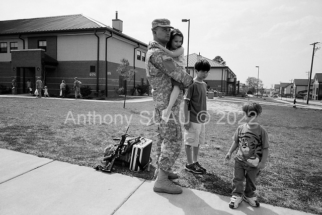 Columbus, Georgia.USA.March 12, 2007..450 soldiers of the third Infantry, third Brigade are deployed to Iraq from Fort Benning, Georgia. Many of the men are being deployed for their second or third tour of duty...Soldiers spent their last few minutes with their families on the base before separating from them and boarding a bus to the base airport...Nathon Twigg spends the last few minutes with his family Mathea (6), Dillion (10), and Cuyler (2), before being deployed to Iraq...
