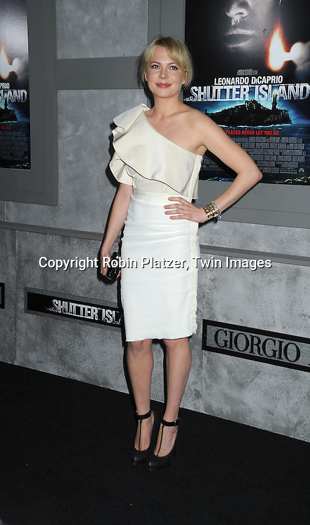 actress Michelle Williams in Lanvin white dress