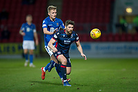 29th December 2019; McDairmid Park, Perth, Perth and Kinross, Scotland; Scottish Premiership Football, St Johnstone versus Ross County; Iain Vigurs of Ross County challenges for the ball with Alistair McCann of St Johnstone  - Editorial Use