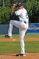 Asheville Tourists Peter Tago #26 throws a pitch in a special side session at McCormick Field in Asheville,  North Carolina;  May 19, 2011.  Photo By Tony Farlow/Four Seam Images