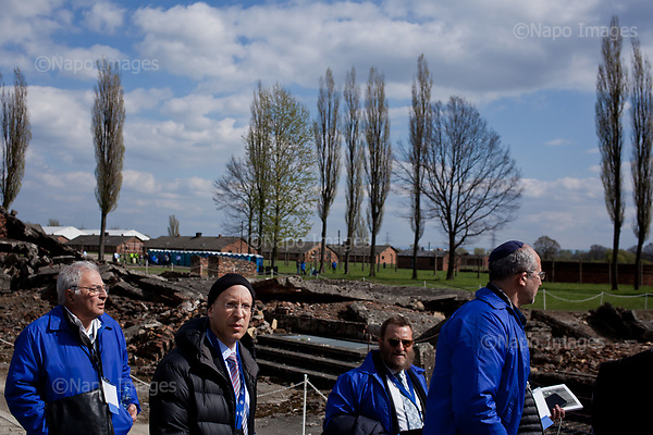 OSWIECIM, POLAND, APRIL 24, 2017:<br /> Elisha Wiesel is reflecting by the ruins of the crematorium, with from Syndey Amir, Rabbi Schmuley Boteach and Sydney Amir, during the &quot;March of The Living&quot; an annual march between two camps of the Auschwitz concentration camp.  Elisha Wiesel is a chief technology officer at Goldman Sachs in New York and the only son of Holocaust memoirist Eli Wiesel. After death of his father he has decided to step forward and take a more public role, carrying on his father's work.<br /> (Photo by Piotr Malecki / Napo Images)<br /> ###<br /> OSWIECIM, 24/04/2017:<br /> Elisha Wiesel, syn slawnego Eli Wiesela, bierze udzial w Marszu Zywych w Oswiecimiu. Po smierci ojca Elisha postanowil kontynuoawc jego dzielo.<br /> Fot: Piotr Malecki / Napo Images<br /> <br /> ###ZDJECIE MOZE BYC UZYTE W KONTEKSCIE NIEOBRAZAJACYM OSOB PRZEDSTAWIONYCH NA FOTOGRAFII###