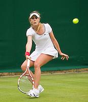 Alize Cornet<br /> <br /> Tennis - The Championships Wimbledon  - Grand Slam -  All England Lawn Tennis Club  2013 -  Wimbledon - London - United Kingdom - Monday 24th June  2013. <br /> &copy; AMN Images, 8 Cedar Court, Somerset Road, London, SW19 5HU<br /> Tel - +44 7843383012<br /> mfrey@advantagemedianet.com<br /> www.amnimages.photoshelter.com<br /> www.advantagemedianet.com<br /> www.tennishead.net