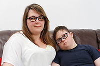 Pictured L-R: Victoria Baynham with son Alex Jones. Friday 02 February 2018<br /> Re: 12 year old Alex Jones, who has Down's Syndrome, was not dropped off home by bus company CJ Contract Travel Services but instead was discovered at the company's depot in Barry, south Wales, on his way back from Ysgol Y Deri School in nearby Penarth.