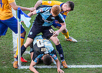 Ryan Sellers of Wycombe Wanderers & Luke O'Nien of Wycombe Wanderers try to run the clock down from a corner during the Sky Bet League 2 match between Wycombe Wanderers and Mansfield Town at Adams Park, High Wycombe, England on 25 March 2016. Photo by Andy Rowland.